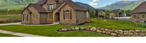 Stone retaining wall in front of a home